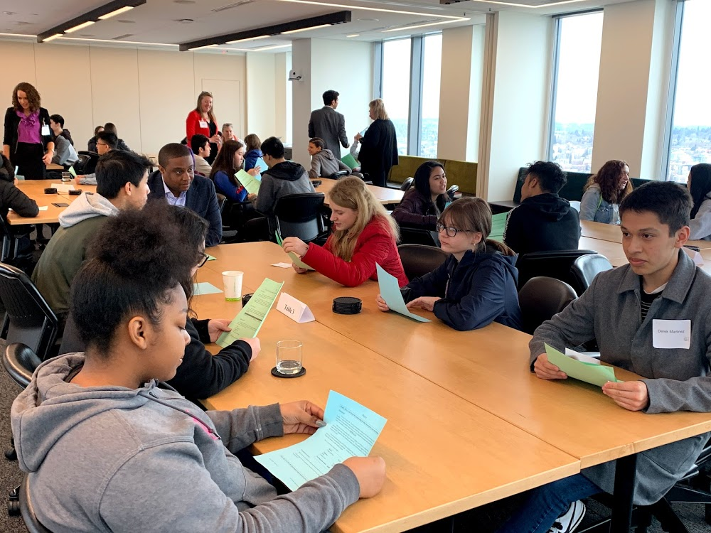 Students from Jefferson High School learn how to negotiate at the law firms of Davis Wright Tremaine LLC.