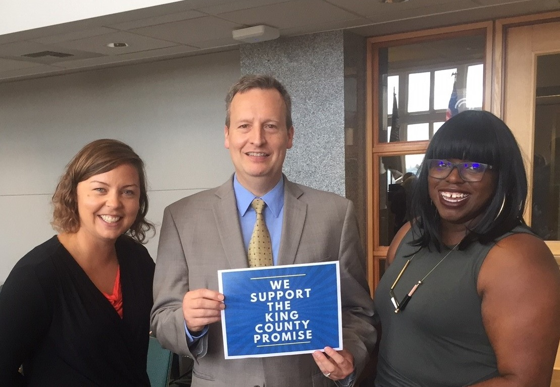 Puget Sound College and Career Network director Kyla Lackie and manager Mercy Daramola with councilmember Dave Upthegrove at the King County Council PSTAA hearing on Aug. 28.