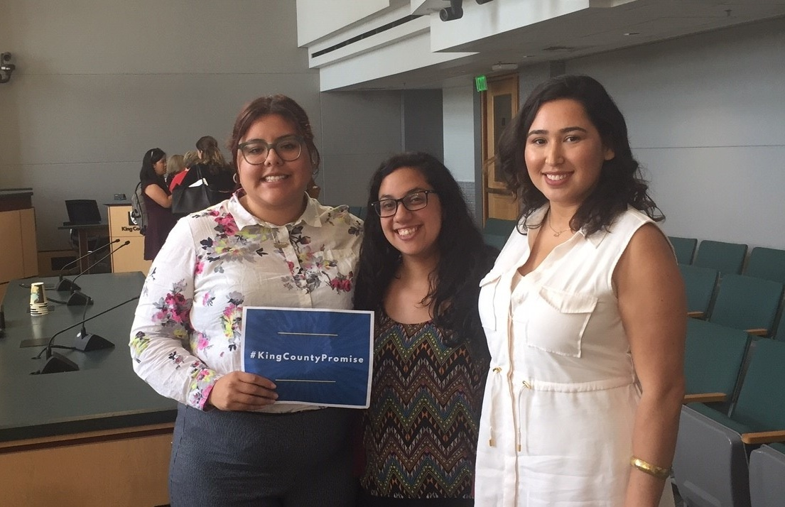Community Center for Education Results College & Career coordinator Larissa Reza and manager Alejandra Pérez with UW Gear Up Achievers assistant director Marycarmen Becerra-Nuñez at the King County Council PSTAA hearing on Aug. 28.