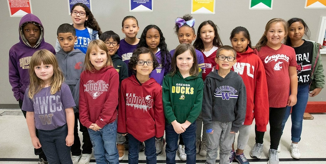 Students from Brigadoon Elementary School in Federal Way show off their college gear during DiscoverU 2019